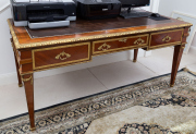 Sale 8677B - Lot 879 - A Louis XVI style parquetry and ormolu, leather top, bureauplat desk with three drawers on tapering legs H x 83cm, W x 183cm, D x 88cm