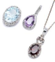 Sale 8946 - Lot 308 - THREE STERLING SILVER DIAMOND AND STONE SET PENDANTS; set with oval cut pale blue topaz, and garnet and pearl cut amethyst all to de...