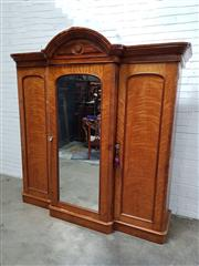 Sale 9068 - Lot 1018 - Victorian Satinwood Breakfront Wardrobe, with central mirrored door, flanked by two timber arched panel doors (h:225 x w:215 x d:66cm)