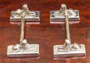 Sale 8284A - Lot 84 - A pair of 1920's silverplate carver rests in the form of sphinx. L: 10cm