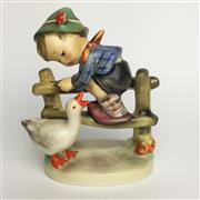 Sale 8456B - Lot 34 - Hummel Figure of a Boy on Fence with a Goose