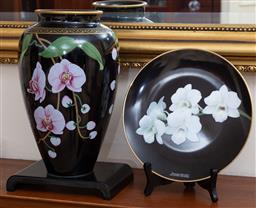 Sale 9155H - Lot 29 - A Franklin Mint ceramic vase depicting orchids on black ground Height 26cm, together with a matching cabinet plate