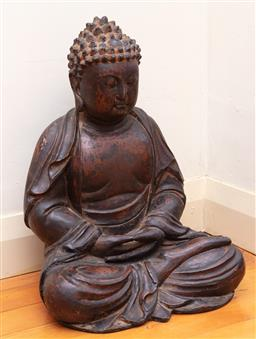 Sale 9190H - Lot 102 - An antique well carved wood Chinese Buddha in variegated black finish, probably 18th century. Height 60cm x Width 44cm