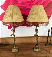 Sale 8205 - Lot 93 - A pair of acanthus form table lamps with pleated cream and amber beaded shades, H 87cm