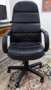 Sale 8677B - Lot 881 - A black leather office chair