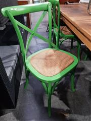 Sale 8717 - Lot 1019 - Set of 4 Green Finished Cross-Backed Chairs with padded rattan seats