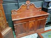 Sale 8576 - Lot 1022 - Victorian Scottish Mahogany Sideboard, with carved back, two drawers & two panel doors flanking a blind panel, bearing paper cabinet...