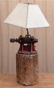 Sale 8984H - Lot 7 - A Wombat Hollow lamp, the base constructed from a Lister sheep shearing blade sharpening wheel mounted over a hardwood stump with a...