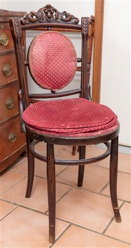 Sale 9120H - Lot 358 - A timber chair with carved crest and fabric panel seat back. Height of back 95cm