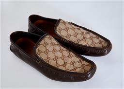 Sale 9095F - Lot 12 - A pair of mens Gucci leather monogrammed loafers, size 40.