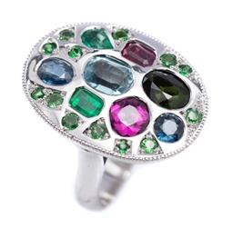Sale 9194 - Lot 507 - A 9CT WHITE GOLD GEMSET COCKTAIL RING; oval plaque top 24.5 x 18mm, set with an emerald and pear cut emerald, a round and oval cut b...
