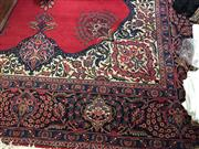 Sale 8310A - Lot 453 - A Persian Kashan carpet, with a central medallion on red ground with floral border, approx 311 x  215cm