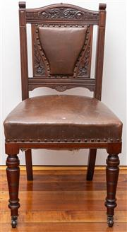 Sale 8590A - Lot 31 - A single leather upholstered Edwardian dining chair with floral carving and studded detail, on front castors