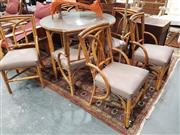 Sale 8745 - Lot 1015 - Cane Seven Piece Dining Setting incl. Round Glass Top Table & Six Chairs with Upholstered Seat