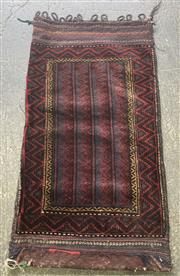 Sale 9068 - Lot 1033 - East Persian Wool Bag or Cushion Cover, in deep tones of red, blue & yellow (100 x 58cm)
