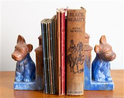 Sale 9103M - Lot 751 - A small collection of vintage childrens books with a pair of English made ceramic dog form bookends.