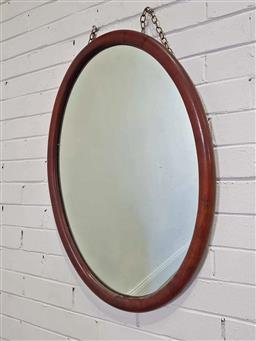 Sale 9179 - Lot 1087 - Possibly Walnut Oval Mirror, with half-round cross-banded frame (84 x 52cm)
