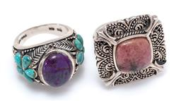Sale 9213 - Lot 319 - TWO SILVER STONE SET RINGS; one centring an oval purple and green ornamental stone to shoulders set with turquoise clusters, size P,...