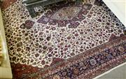 Sale 8205 - Lot 94 - A large Persian Isfahan carpet, floral motif on cream ground, 300 x 420cm