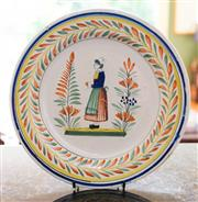 Sale 8270 - Lot 87 - A painted French pottery wall plate, signed to the back, Henriot Quimper, France. D 29cm