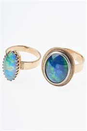 Sale 8293 - Lot 332 - TWO 9CT GOLD OPAL RINGS; each set with an opal triplet, size L, wt. 10.9g.