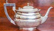 Sale 8284A - Lot 78 - An English hallmarked sterling silver teapot with half fluted decoration. Chester, 1898. Ht: 11cm.