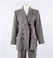 Sale 8760F - Lot 161 - A brand new Yves Saint Laurent Encore textured wool suit, to include a vintage double breasted blazer and pleated pants, both size U...