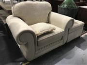Sale 8942 - Lot 1021 - Oversized Fabric Upholstered Armchair and Footstool (H: 79, W: 108, D: 90cm)