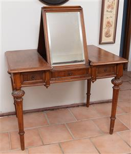 Sale 9120H - Lot 361 - A C19th French walnut dressing table with carved and fluted legs, the central bevelled mirror folding out of the drawer. Height when...