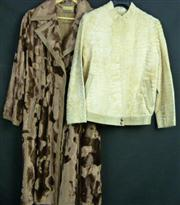 Sale 7982B - Lot 115 - Two Faux fur jackets, one 3/4 length by Helen Sorrel the other a zip up waist length