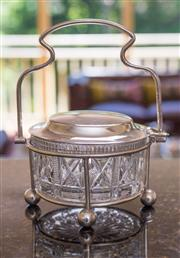 Sale 8270 - Lot 89 - A silverplate and glass preserves dish, the mechanical swing handle opens & closes the lid. Rg D.535139, C: 1910, W 14cm