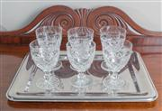Sale 8470H - Lot 95 - A rectangular stainless steel tray with cushioned border together with six cut crystal wine glasses, L of tray 40cm