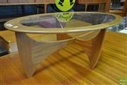 Sale 8528 - Lot 1050 - Oval G-Plan Teak Atmos Coffee table with Glass Top