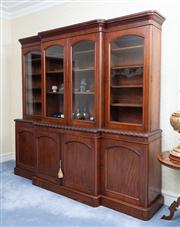 Sale 8815A - Lot 96 - A C19th mahogany bookcase with four glazed doors above four panelled doors and an ovoid carving to shelf, H x 230cm, W x 250cm, D x ...