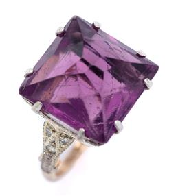 Sale 9194 - Lot 574 - A STONE SET RING;  set with a purple pyramid shape paste in gold plate top to later 18ct gold shank set with 3 round brilliant cut d...