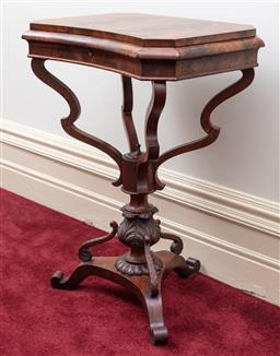Sale 9190H - Lot 275 - An antique English flame mahogany multi compartment sewing table C: 1860. The shaped top opening to reveal 10 interior walnut lidded...