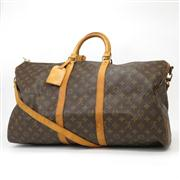 Sale 8362A - Lot 28 - A vintage French Louis Vuitton Keepall travel bag with shoulder strap, 60cm
