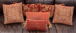 Sale 9160H - Lot 103 - A group of six red scatter cushions, including floral and manuscript examples