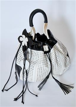 Sale 9095F - Lot 72 - A Gianni Versace vintage black and white leather handbag with gold hardware and daisy leather detail, tassels, width 35cm.