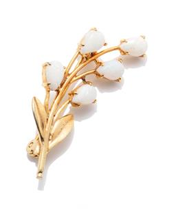 Sale 9253J - Lot 525 - AN OPAL SPRAY BROOCH; gold plated stem and leaves set with 5 pear cabochon solid white opals, size 37 x 14mm.