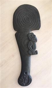 Sale 8259A - Lot 45 - An Early Maori War Club or Patu, well carved with a man's head and blade, each profusely decorated, length 42cm