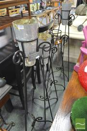 Sale 8262 - Lot 1088 - Set of Four Iron Flower Stands