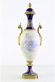Sale 8952 - Lot 4 - Louis XVI Style Porcelain Urn with Gilt Brass Mounts, with landscape & figural panel signed L Jurancy (?) & simulated lapis bands