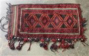 Sale 9071 - Lot 1018 - Persian Wool Cushion Cover, with red diamonds on black filed, having partial tassels (114 x 58cm)