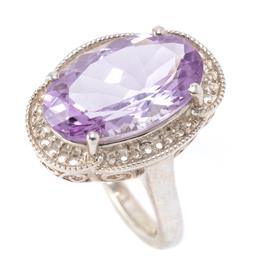 Sale 9177 - Lot 362 - A SILVER AMETHYST COCKTAIL RING; claw set with an oval cut amethyst of approx. 8.39ct, top 22 x 16.5mm, size N 1/2, wt. 6.98g.