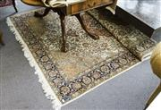 Sale 8205 - Lot 95 - A Persian carpet profusely decorated with floral motif on cream ground, approx 182 x 252cm