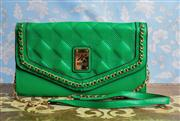 Sale 8577 - Lot 20 - A large Kardashian Kollection envelope green leather clutch/ handbag, featuring gold chain detail & quilted style pattern along the...