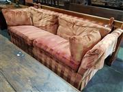 Sale 8774 - Lot 1051 - Moran Knole Settee, in two-tone orange striped velvet, with ribbon tied upholstered finials and matching cushions (slight wear). W...