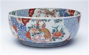 Sale 9080J - Lot 198 - An antique Japanese porcelain bowl decorated to the exterior with 4 panels of Foo dogs and trees, seperated by panels of scrolling l...