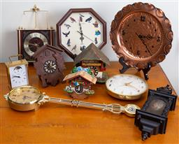Sale 9103M - Lot 754 - A collection of assorted clocks including cuckoo clocks, carriage clocks, and others.